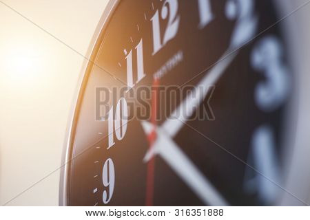 Close-up On Wall Clock In Office Before Going To Work Early Or Finish Working. Working Time In Offic