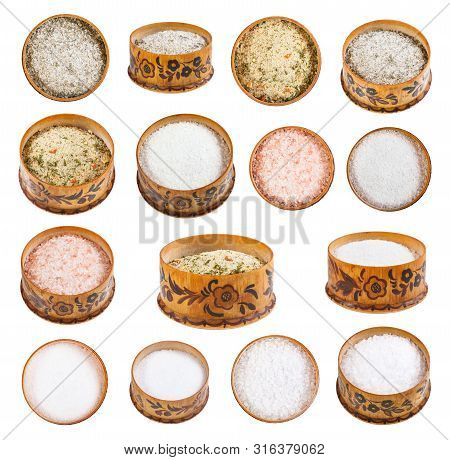 Collection From Wooden Salt Cellar With Various Salts Isolated On White Background