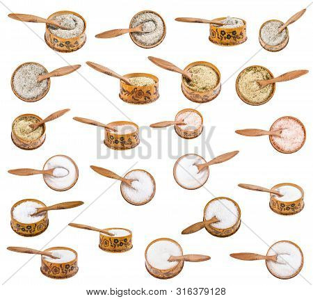 Set Of Wooden Salt Cellar With Little Spoon With Various Salts Isolated On White Background