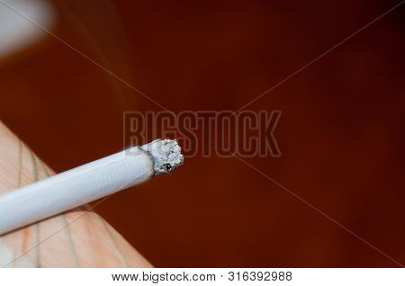 The Harm Of Smoking. Lit Cigarette. Lasting Cigarette. Cigarette Copy Space. Harm To Health. Bad Hab