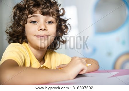 Happy Boy Making Pictures With Pencil Stock Photo