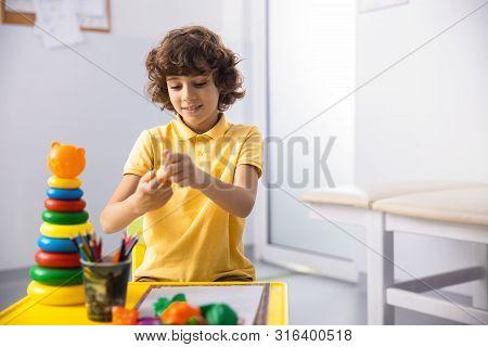 Jolly Boy Playing With Toys In Hospital Stock Photo