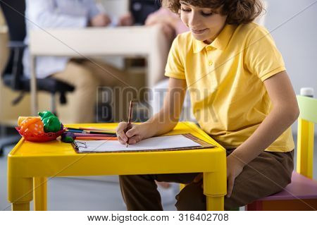 Smiling Boy Making Picture At Doctor Stock Photo
