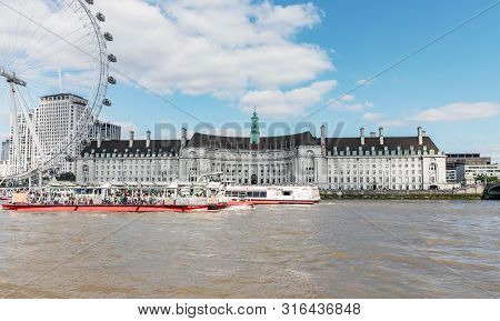 London / Uk, July 15th 2019 - County Hall And The London Eye, Viewed From Across The River Thames
