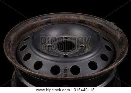 Lead weights on the rim. Accessories for the vulcanizer in the workshop. Dark background. poster
