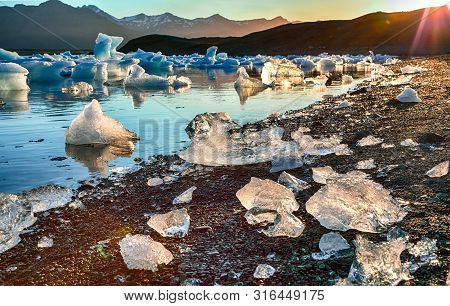 Beautifull Landscape With Floating Icebergs In Jokulsarlon Glacier Lagoon At Sunset. Location: Jokul