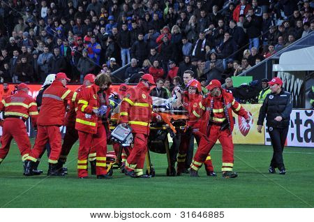 Paramedics giving first aid for soccer player