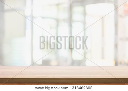 Empty Top Of Wood Table With Blur Living Room Interior Background.