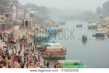 Chitrakoot, India: Misty Morning In City With Crowd Of Business People And Many Riverboats On Indian