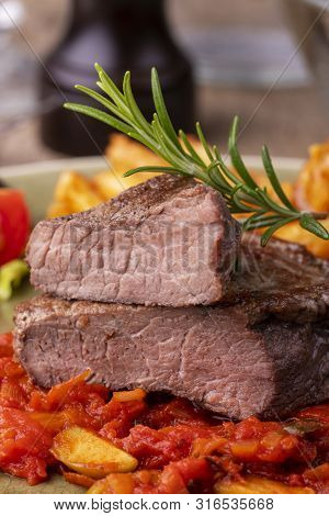 Grilled Steak On A Plate With Rosemary
