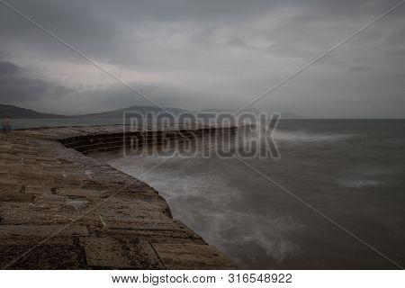 Long Exposure Of Lyme Regis Pier In Dorset