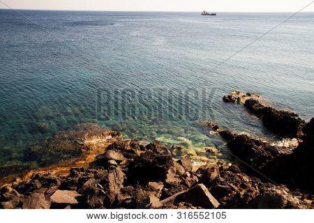Akrotiri Beach, Santorini Island, Greece. It Is A Long Beach With Crystal Clear Pebble Water With La
