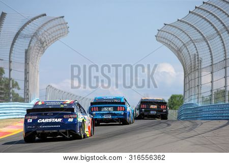 August 04, 2019 - Watkins Glen , New York, USA: Kevin Harvick (4) battles for position for the Go Bowling at The Glen at Watkins Glen International in Watkins Glen , New York.