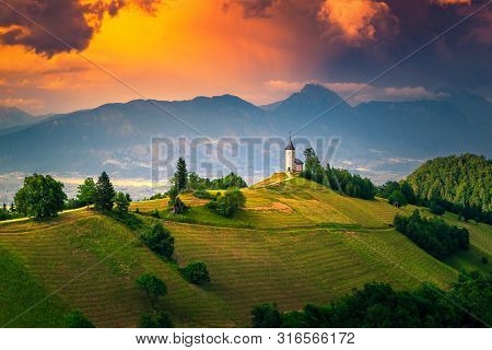 Mountain Landscape With Church On The Hill. Beautiful Colorful Sunset Landscape And Spectacular Sain