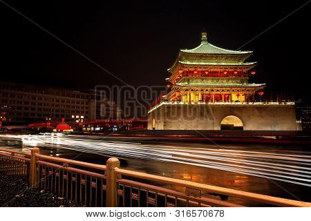 A Dramatic Long Exposure Of The Drum Tower In Xian China With The Lights Of Vehicles Flowing In Fron