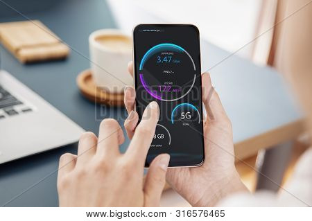 Woman Checks Wireless Connection Of 5g Technology On Her Smartphone. Interface On The Screen Was Cre