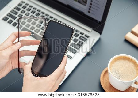 Woman's Hands Hold Smartphone And Its Silicone Case
