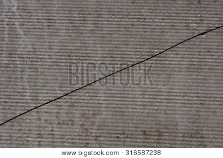 Gray Dark Background Of A Concrete Wall With A Crack