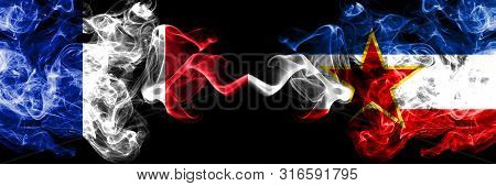 France Vs Yugoslavia Smoky Mystic Flags Placed Side By Side. Thick Colored Silky Abstract Smokes Ban