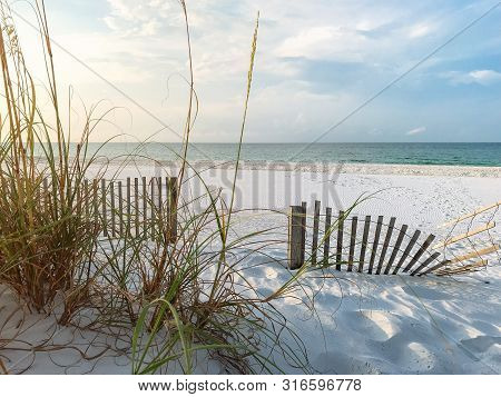 Sand Fences Lessen Erosion On Snow White Sandy Beaches In Florida In The Summer.