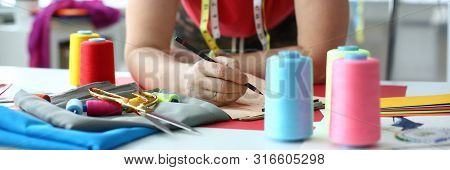 Dressmaking And Sewing Concept Fashion Designer. Male Dressmaker At Workplace. Craftsman With Measur