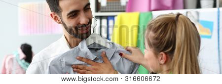 Assistant Buyer Fashion Tailor Profession Concept. Blond Woman Standing Near Male Client Fitting On