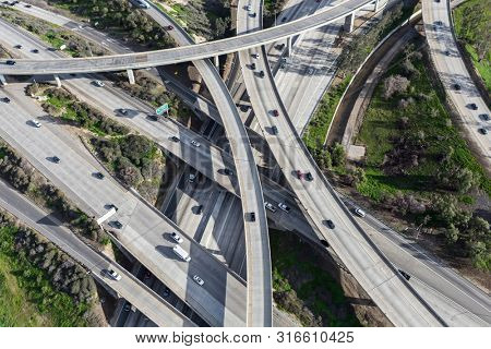 Aerial view of Interstate 5 and Route 118 freeway interchange bridges in the San Fernando Valley area of Los Angeles, California.