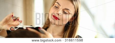 Young Woman Hairstylist Cutting Male Client Hair. Beautiful Hairdresser Holding Scissors for Haircut. Female Stylist Trimming Man Hairdo in Beauty Salon. Beautician Making Hairstyle for Guy Client poster