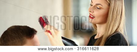 Blonde Hairdresser Using Hairbrush for Hairstyle. Hairstylist Making Haircut for Man Client with Dryer. Woman Stylist Blowing By Hairdryer on Male Customer. Beautician Drying Hair in Beauty Salon poster
