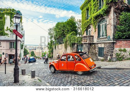 Paris, France - July, 21, 2019: Beautiful Old Street In Montmartre District In Paris, France. Orange