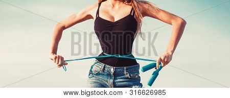 Athletic Slim Woman Measuring Her Waist By Measure Tape After Diet. Girl With Perfect Waist With A J