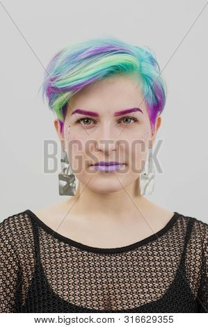 Young Beautiful Woman With Dyed Blue And Green Hair. Pixie Bob Short Haircut The Concept Of Hair Sty