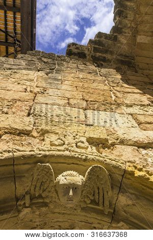 Otranto: Detail Of The Ancient City Walls Depicting A Winged Cherub; Otranto Is One Of The Most Visi