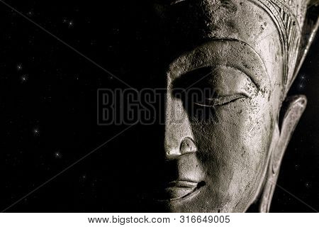 Spiritual Universe. Buddha And The Night Sky. Face Of God And Religion. Pure Creation And Light From