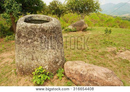 Ancient Stone Jars In A Plain Of Jars (site #2) Near Phonsavan,  Xienghouang Province, Laos.