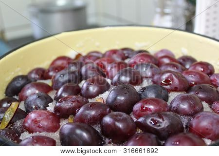 Photo Of Fresh Plums.fruits Are In The Pan.