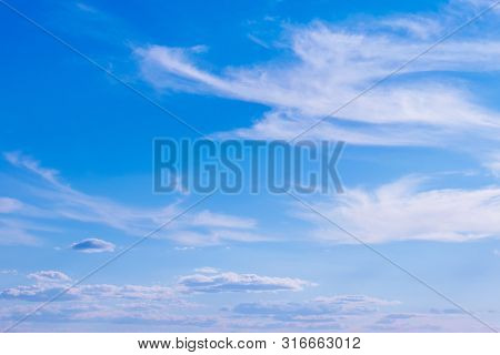 Blue Background Of The Sky And Feathery Clouds. Light, Fibrous, Airy Formations, Fibers Randomly Sca