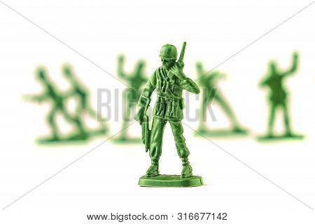 Lot Of Plastic Toy Soldiers On White Background.