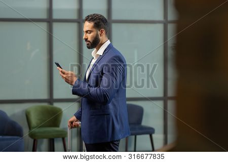 Profile Photo Of Serious Man That Reading Message