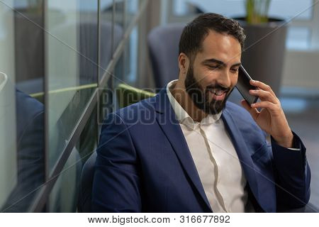 Kind Bearded Businessman Having Pleasant Telephone Talk