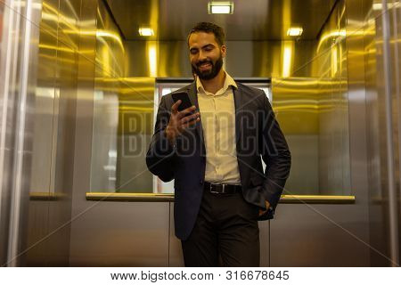 Kind Bearded Male Person Reading Income Message