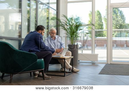 Concentrated Mature Male Person Staring At Computer