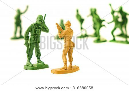 Miniature Toy Soldiers On White Background, Close-up