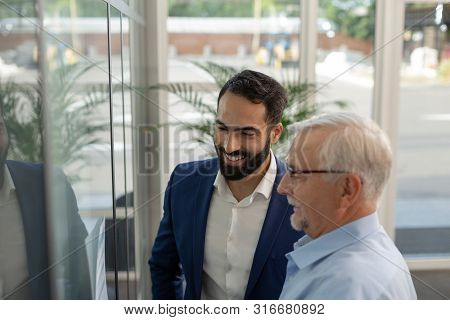 Close Up Of Young Businessman That Looking At Scheme