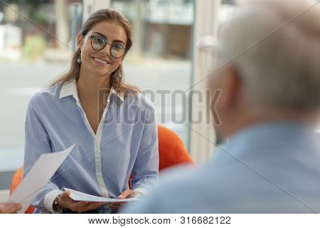 Close Up Of Charming Girl That Listening To Her Boss