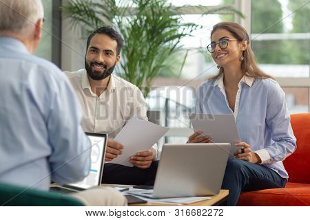 Charming Longhaired Woman Listening To Project Presentation