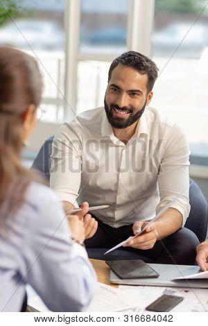 Handsome Bearded Male Person Presenting His Idea
