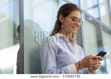 Close Up Of Pretty Office Worker That Reading Message