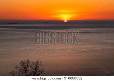 Sunset Over The Sea Horizon Nature Landscape. Red Clouds And Sea Landscape. Sea Nature In Sunset. Na