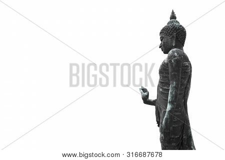 Buddha Statue Standing On White Background. Buddhism Is Popular Region In China Japan And South East